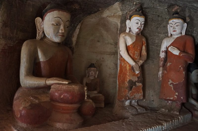 Monk and Buddha Statue inside Po Win Taung Cave complex