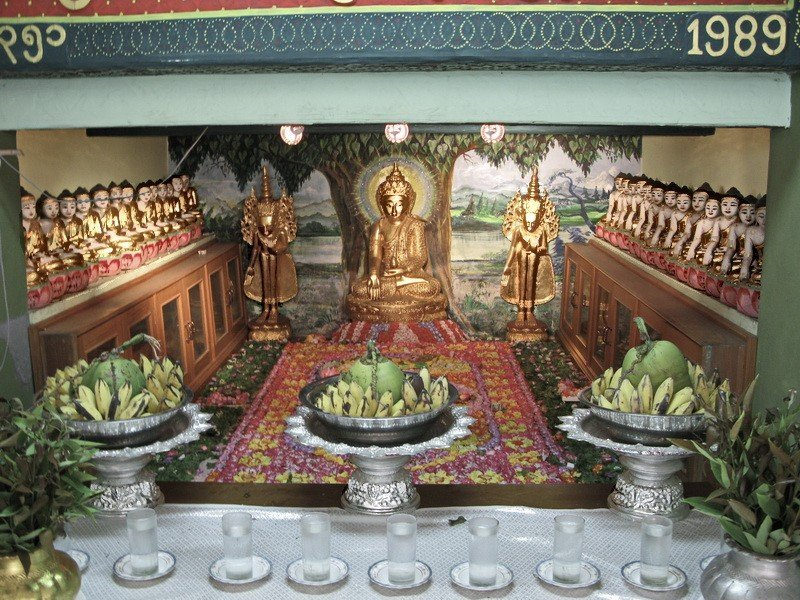 Offerings to the Buddha Mya Kyauk Pagoda
